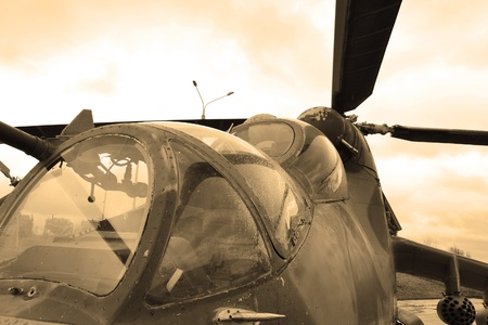 wartime: The photo of a military helicopter cockpit. Sepia. Editorial