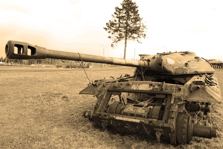 The photo of rusty old soviet military tank. Sepia. Stock Photo - 10650307