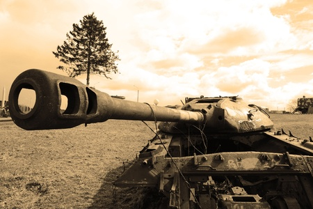 war and military: The photo of old soviet tank. Sepia.