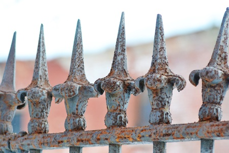 safekeeping: Old rusty iron fence a blurred background Stock Photo