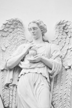 Architectural old church fragment, angel sculpture . Black and white photo