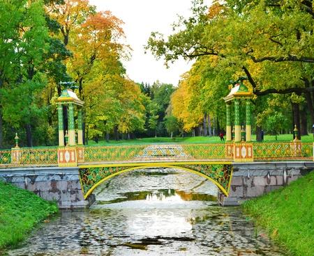 Bridge across canal in Alexander`s park in Tsarskoe Selo (Pushkin), Saint Petersburg, Russia photo