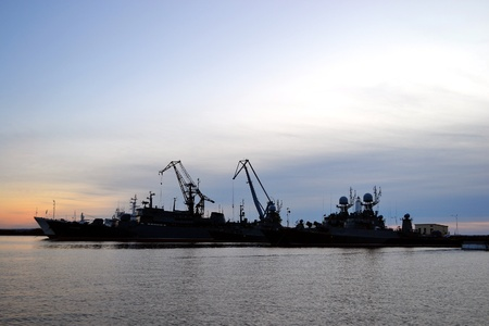 Russian power of navy base in Kronstadt at sunset background, Russia photo