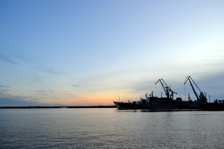 strong base: Russian power of navy base in Kronstadt at sunset background, Russia Stock Photo
