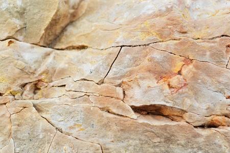 Close-up van bruin grijze rots. Textuur of achtergrond.