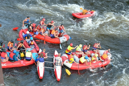 frantic: River Vuoksi, Leningrad Region, Russia - 2 July 2011:  Unidentified persons enjoy a day of whitewater rafting
