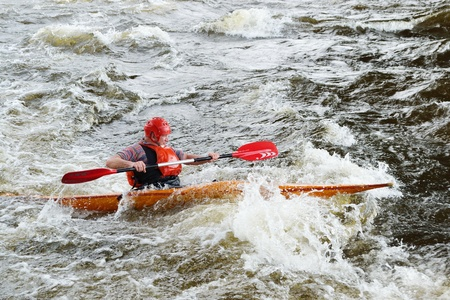 River Vuoksi, Leningrad Region, Russia - 3 July 2011: Kayaker sporting a kayak cuts through water.