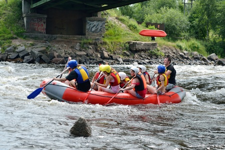 River Vuoksi, Leningrad Region, Russia - 3 July 2011:  Unidentified persons enjoy a day of whitewater rafting