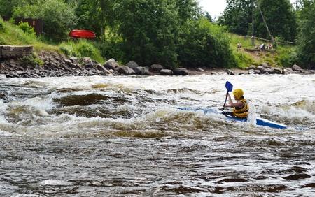 kayaker: River Vuoksi, Leningrad Region, Russia - 3 July 2011: Kayaker sporting a kayak cuts through water.