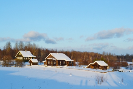 View of snowy russian village at winter day