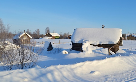 View of snowy russian village at winter day photo
