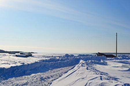 onega: Coast of frozen Onega lake, sunny winter day, Russia.