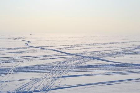 Ski tracks on frozen Gulf of Finland, sunny winter day, Russia. Reklamní fotografie