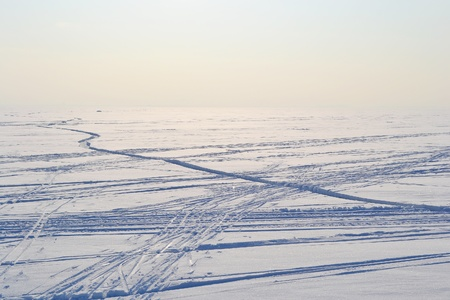 Ski tracks on frozen Gulf of Finland, sunny winter day, Russia. photo