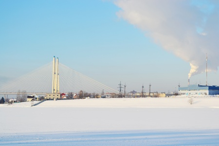 View of frozen River Neva and cable-stayed bridge, outskirts of St. Petersburg, Russia