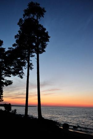 The photo of summer sunset on lake Ladoga photo