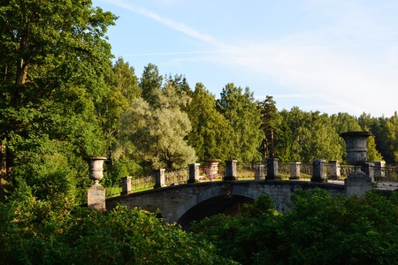 Summer landscape - bridge on river, recorded in park in Pavlovsk, surroundings of St. Petersburg, Russia. photo
