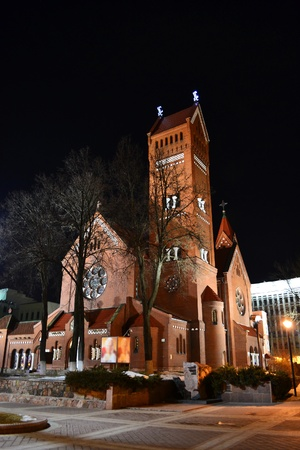 Red Catholic church in the center of Minsk at night, Belarus photo