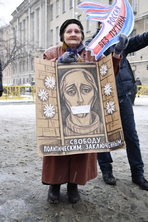 St.Petersburg, Russia - December 24, 2011: The old lady protested at an opposition rally in the square Sakharov