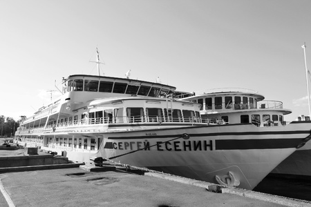 St.Petersburg, Russia - May 24, 2011: River cruise ships to berth quay in St. Petersburg. Black and white