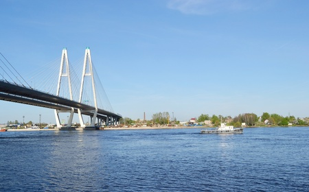 Cable-braced bridge across the river Neva on a sunny spring day, Russia, St. Petersburg. photo