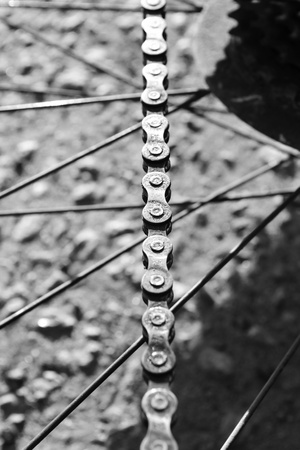 Bicycle chain on a blurred background. Black and white photo