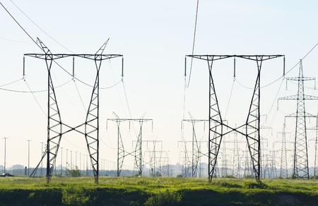 transmission line: View of electricity pylons on a sunny day Stock Photo