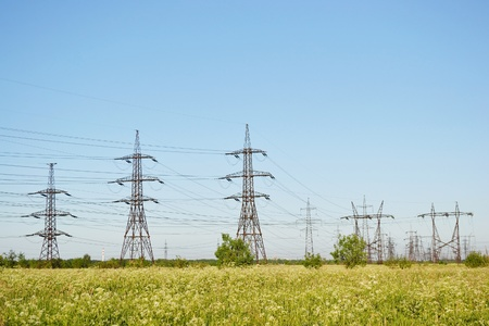 Summer landscape with electricity pylons, Russia photo