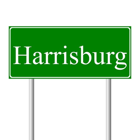roadtrip: Harrisburg green road sign isolated on white background