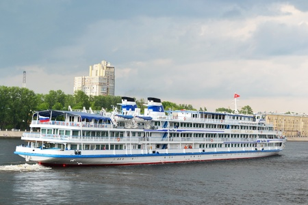 St.Petersburg, Russia - May 28, 2011: River cruise ship sailing on the river Neva on cloudy summer day