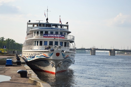 St.Petersburg, Russia - May 28, 2011: River cruise ship to berth quay in St. Petersburg on a sunny summer day