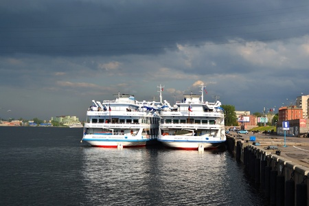 St.Petersburg, Russia - May 28, 2011: River cruise ships to berth quay in St. Petersburg on a cloudy summer day