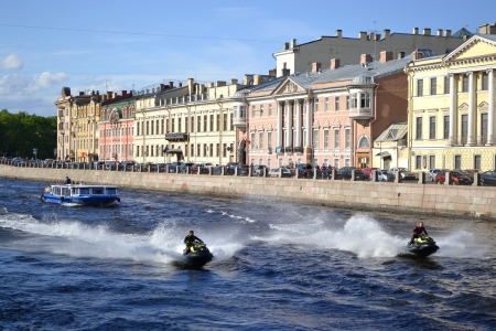 View of Fontanka canal  Two jet ski sail through the channel  St Petersburg, Russia Stock Photo - 14137593