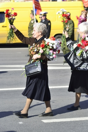 St. Petersburg, Russia - May 9, 2012: Female veteran of World War II on Victory parade