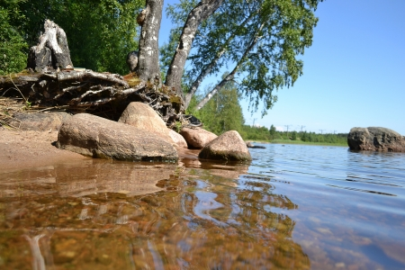 The shore of the lake with stones, the Karelian Isthmus, Russia photo