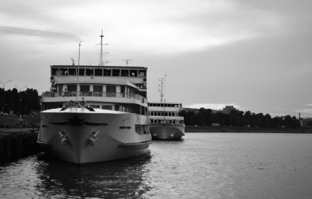 River cruise ship to berth quay in St. Petersburg. Black and white photo