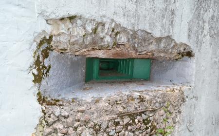 embrasure: Embrasure of old military bunker from World War II in Sestroretsk, Russia