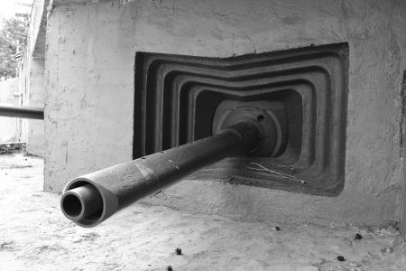 Embrasure of old military bunker from World War II in Sestroretsk, Russia. Black and white photo