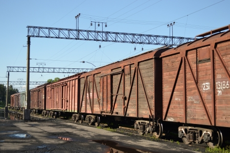 Perspective of the cargo train consisting of hopper wagons photo