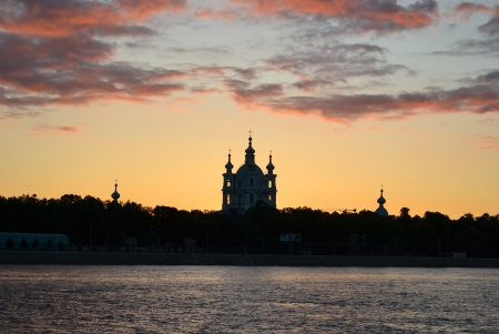 View of Neva river and Smolny Cathedral at sunset in St.Petersburg, Russia photo