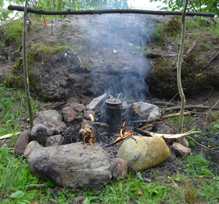 The image of a fire in the woods on which is brewed pot Stock Photo - 14545749