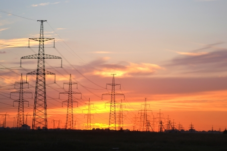 The photo of electric power transmission lines at sunset. Little noise