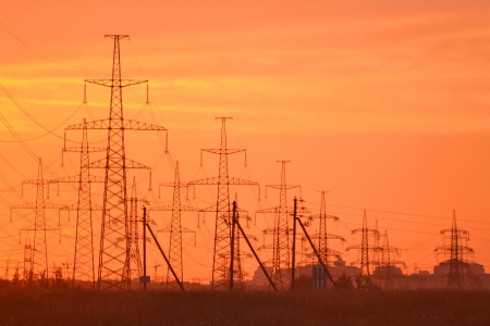 The photo of electric power transmission lines at sunset photo