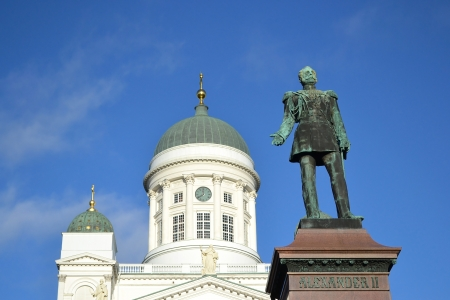 Statue of Russian czar Alexander II against the Cathedral. Senate Square, Helsinki, Finland photo