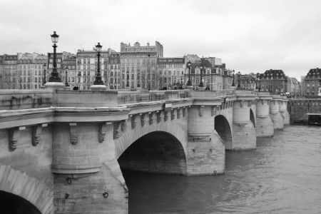 Bridge Pont Neuf across the Seine in Paris, France. Black and white.