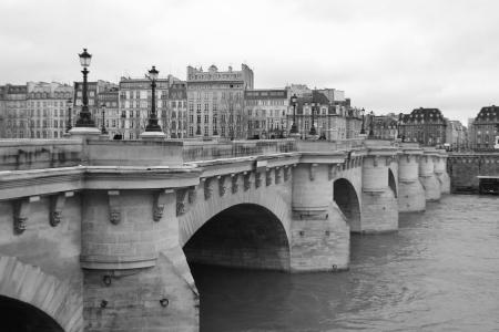 Bridge Pont Neuf across the Seine in Paris, France. Black and white.