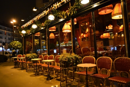 Paris, France - January 7, 2013: tables and chairs in sidewalk cafe