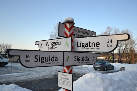 sigulda: Siguldas novads, Latvia - 21 February 2013: Road sign in the countryside near the town of Sigulda