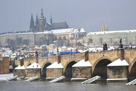 The Prague Castle and the Charles Bridge at winter in Prague, Czech Republic photo