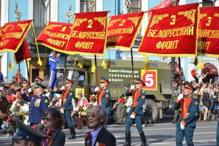 St. Petersburg, Russia - May 9, 2013: Victory parade on Nevsky Prospect in St.Petersburg. Standard-bearers carry the banner of victory